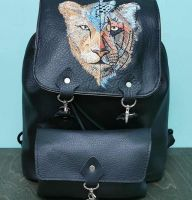 Embroidered leather backpack with unreal lion design