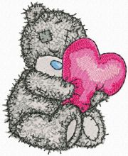 Teddy Bear with a pillow in the form of heart