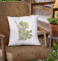 square pillow with coctail embroidery design on a leather chair