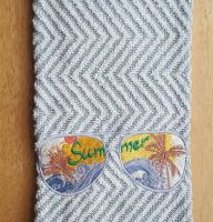 Embroidered beach towel with sunglasses design