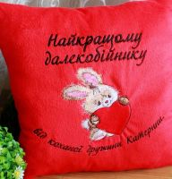 Embroidered cushion with romantic bunny design