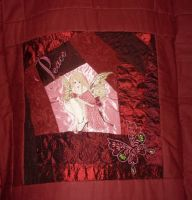 Red quilt block with Modern Fairy embroidery design
