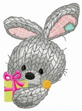 Knitted rabbit with present