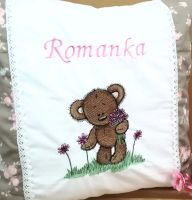 Embroidered pillow with teddy bear design