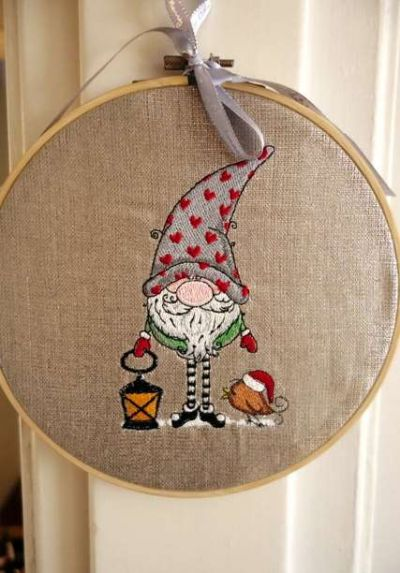 Embroidered Christmas gnome in wooden frame.