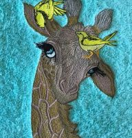 Towel with giraffe embroidery design