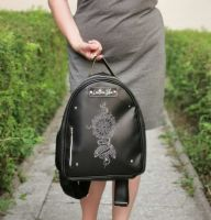 Women leather backpack with embroidered dreamcatcher design