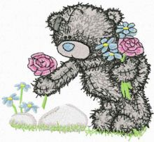 Teddy bear collects flowers