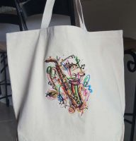 Embroidered beach bag with saxophone design