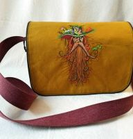 Embroidered bag wirh strange man design