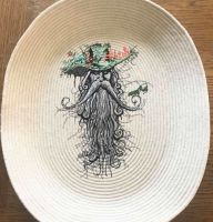 Embroidered candy bowl with root man design