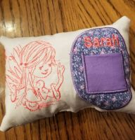 Embroidered cushion with fairy design