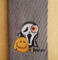 Bathroom towel with Halloween embroidery design