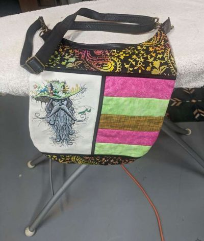 Embroidered bag with fantasy man design