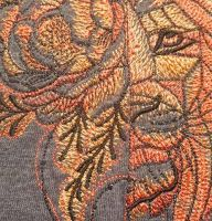 Embroidered lion muzzle design