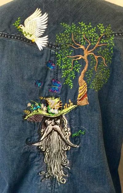 Denim jacket with root man embroidery design