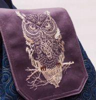 Embroidered item with bird design