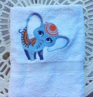 Bath towel with circus elephant embroidery design